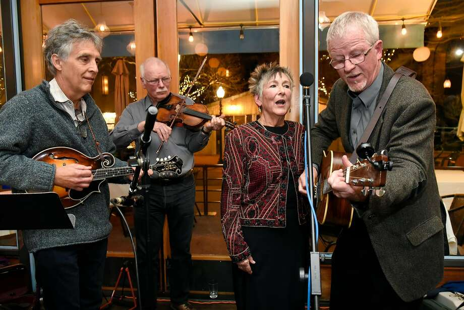 Mandolin player Tom Rozum (left), violinist Ray Bierl and Edmunds' wife, Cornelia St. John, accompany Edmunds in Berkeley. Photo: Michael Short, Special To The Chronicle