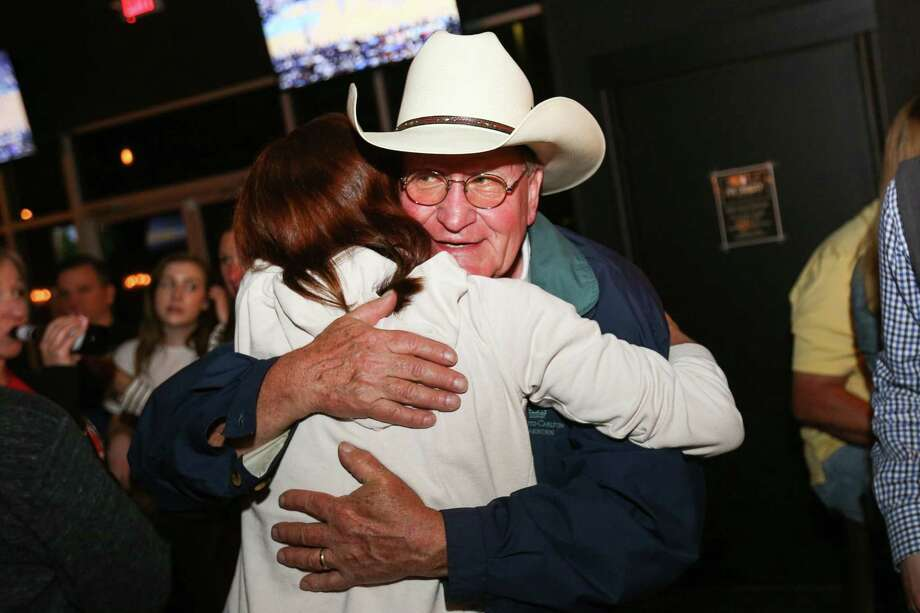 Mark Keough, a GOP candidate for Montgomery County Judge, hugs Kristin Bays, a candidate for 284th District Court judge, on Tuesday, March 6, 2018, at Woodson's. Photo: Michael Minasi / Michael Minasi / Houston Chronicle / © 2017 Houston Chronicle