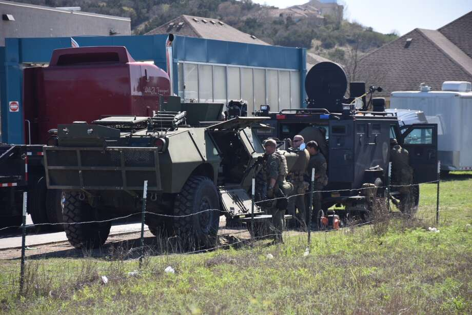 DPS troopers set up equipment at the scene of an hours-long standoff on Wednesday, March 7, 2018 in the 9200 block of Saddle Trail. Photo: Caleb Downs / San Antonio Express-News