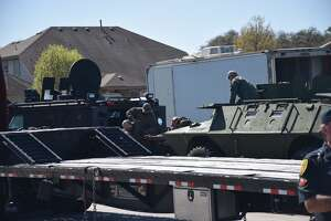 DPS troopers set up equipment at the scene of an hours-long standoff on Wednesday, March 7, 2018 in the 9200 block of Saddle Trail.