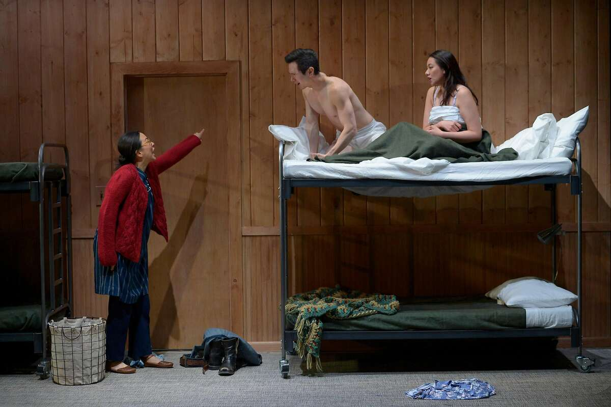 """Huong (Cindy Im, left) walks in on Quang (James Seol, center) and Tong (Jenelle Chu, right) in American Conservatory Theater's """"Vietgone."""""""