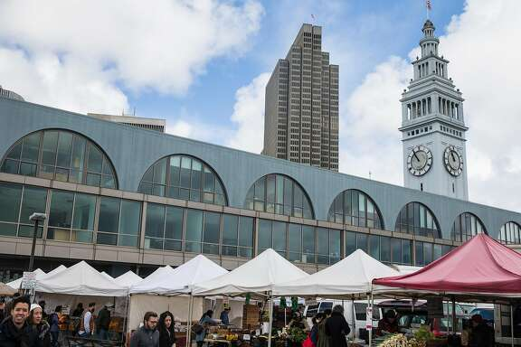 Rows of produce and market booths are seen at the Ferry Plaza Market outside the Ferry Building Saturday, March 3, 2018 in San Francisco, Calif.