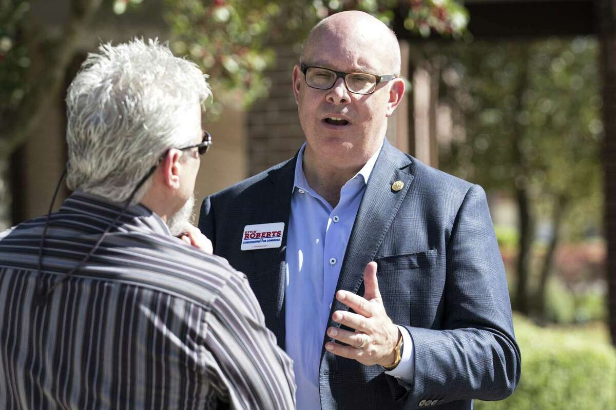 Kevin Roberts, a Republican running for the 2nd Congressional District, talks to voters outside the polling place at Resurrection Lutheran Church on March 6, 2018, in Houston. ( Brett Coomer / Houston Chronicle )
