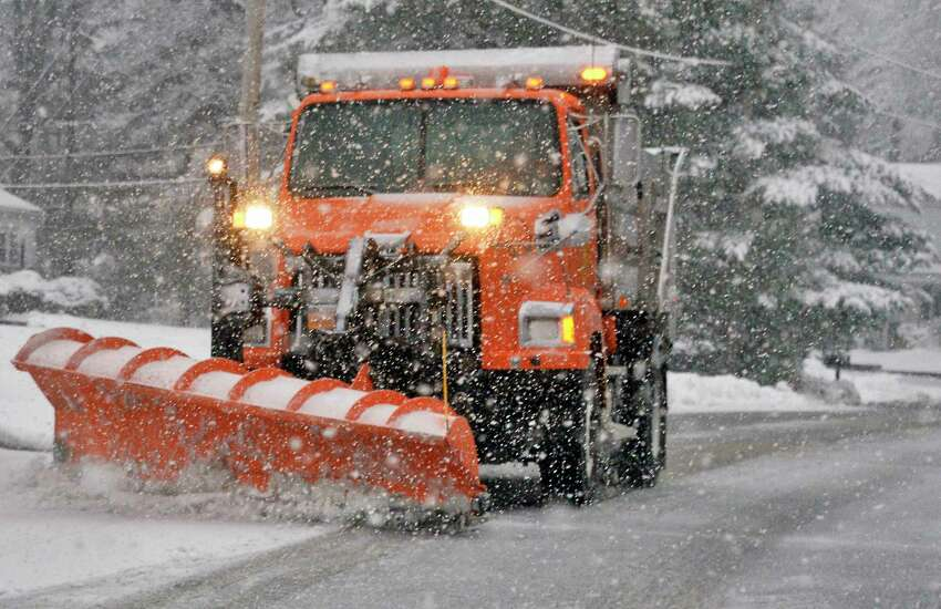 A town snow plow clears a side street as a heavy snow begins to fall Wednesday March 7, 2018 in Clifton Park, NY. (John Carl D'Annibale/Times Union)
