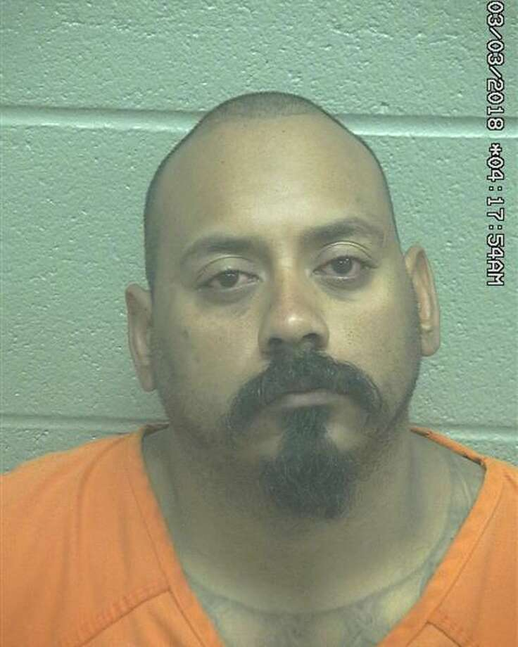 Raul Gonzalez, 32, was being held Wednesday on a $5,000 bond for a third-degree felony charge of assault of a family/house member by impeding breath/circulation and a $500 bond for a Class A misdemeanor charge of interfering with an emergency call. Photo: Midland County Sheriff's Office