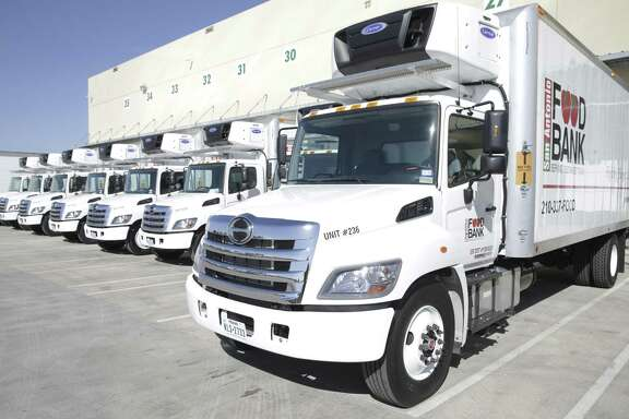 New vehicles are lined up at the docks as the San Antonio Food Bank receives a $1.3 million donation from philanthropist Harvey E. Najim and the Najim Family Foundation on March 7, 2018, that was used to buy 10 new delivery trucks.