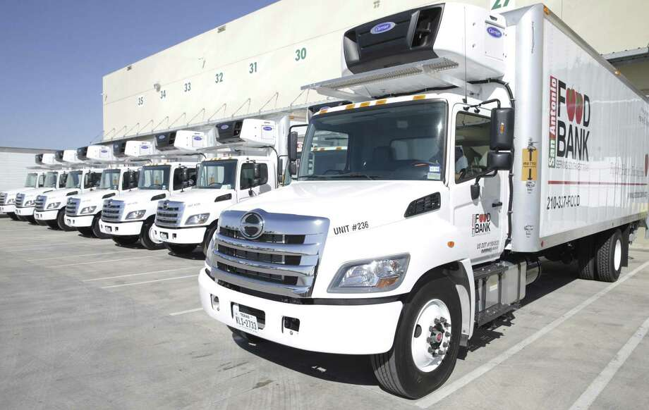 New vehicles are lined up at the docks as the San Antonio Food Bank receives a $1.3 million donation from philanthropist Harvey E. Najim and the Najim Family Foundation on March 7, 2018, that was used to buy 10 new delivery trucks. Photo: Tom Reel /San Antonio Express-News / 2017 SAN ANTONIO EXPRESS-NEWS