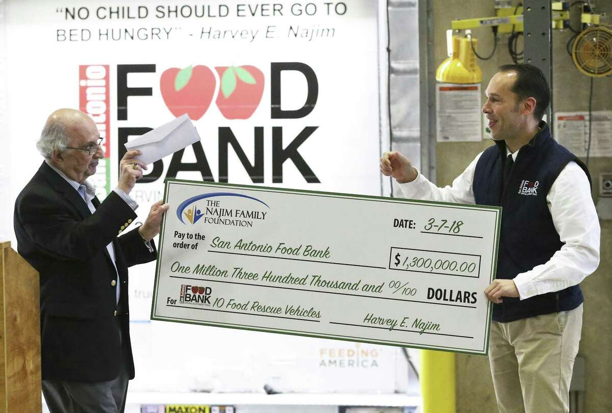 Food Bank CEO Eric Cooper is offered the check as the San Antonio Food Bank receives a $1.3 million donation from philanthropist Harvey E. Najim and the Najim Family Foundation on March 7, 2018, which is used to buy 10 new delivery trucks.