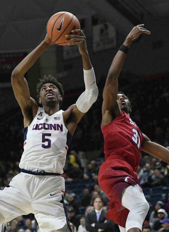 UConn's Isaiah Whaley, left, grabs a rebound over SMU's Jimmy Whitt during their game on Jan. 25 in Storrs. The teams will meet Thursday in the AAC Tournament. Photo: Jessica Hill / Associated Press / AP2018