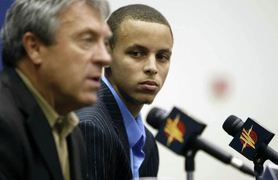 Golden State Warriors top draft pick Stephen Curry listens to comments by then General Manager Larry Riley at a press conference in Oakland on June 26, 2009. Photo: Lance Iversen / The Chronicle / SFC