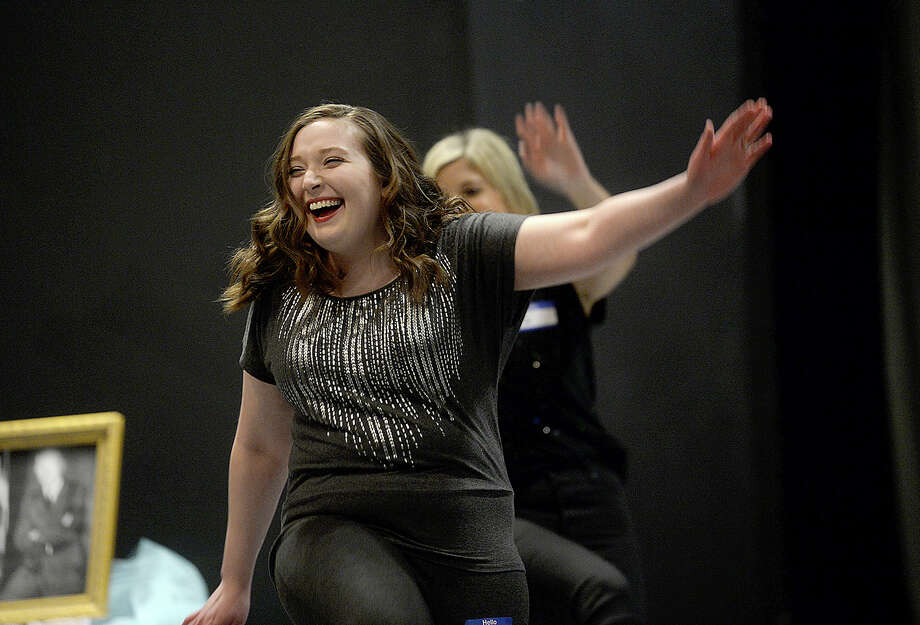 "Marie Panchot reacts as she joins fellow actors learning a dance before auditioning for roles in the Beaumont Community Players' upcoming performance of the musical ""Young Frankenstein"" at the Betty Greenberg Center for the Performing Arts Tuesday. Director Sean McBride will hold call-backs Wednesday and expects to announce the casting decision by this weekend. The show, which had critical acclaim both on stage and screen, will run May 11,12, 18, 19, 24, 25 and 26. Two audition dates were heldthis week, with cast hopefuls showcasing their dancing, singing and comedic skills. Photo taken Tuesday, March 6, 2018 Kim Brent/The Enterprise Photo: Kim Brent / BEN"