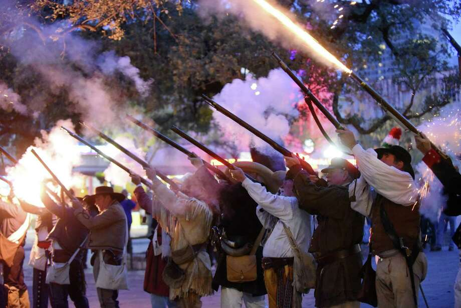 """Members of the San Antonio Living History Association playing the part of the Alamo defenders fire their weapons during the """"Dawn at the Alamo"""" ceremony on Tuesday, March 6, 2018, to commemorate the historic 1836 Battle of the Alamo, where the Texian defenders were overrun by the Mexican Army. Their defeat became the inspiration for the Texians at the Battle of Jacinto, where the forces of Maj. Gen. Sam Houston defeated the forces of Mexican President and General Antonio Lopez de Santa Anna. Photo: Photos By Billy Calzada / San Antonio Express-News / San Antonio Express-News"""