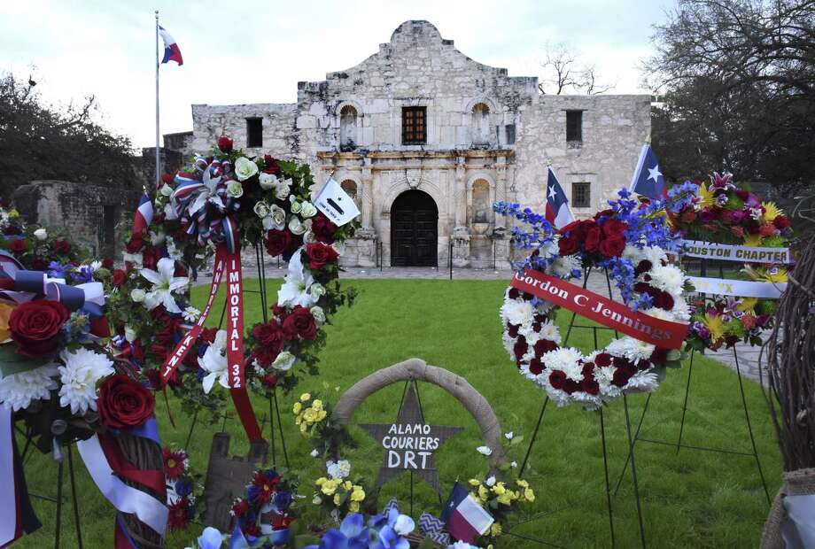 Wreaths honor the Alamo defenders on March 6 to commemorate the historic Battle of the Alamo. A reader discusses who fought and who were heroes. Photo: Billy Calzada /Staff Photographer / San Antonio Express-News