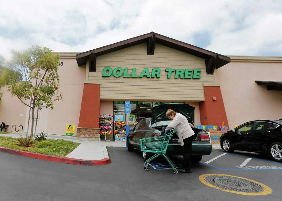 FILE - In this May 26, 2016, file photo, a shopper searches her purse outside a Dollar Tree store in Encinitas, Calif. Dollar Tree, Inc. reports financial results on Wednesday, March 7, 2018. (AP Photo/Lenny Ignelzi, File) Photo: Lenny Ignelzi / Copyright 2016 The Associated Press. All rights reserved. This m