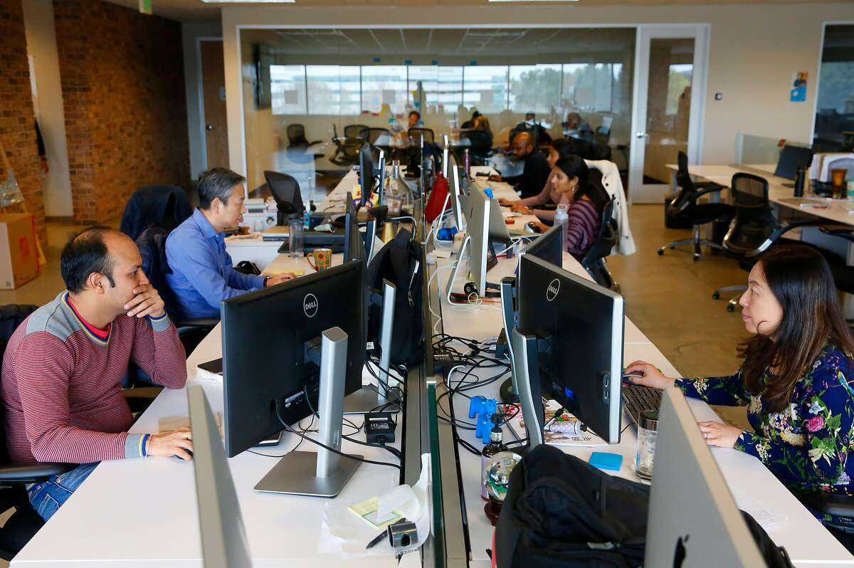 Engineers busy at work at their computer stations at the headquarters of Accela in San Ramon, Calif., on Wed. Feb. 28, 2018.