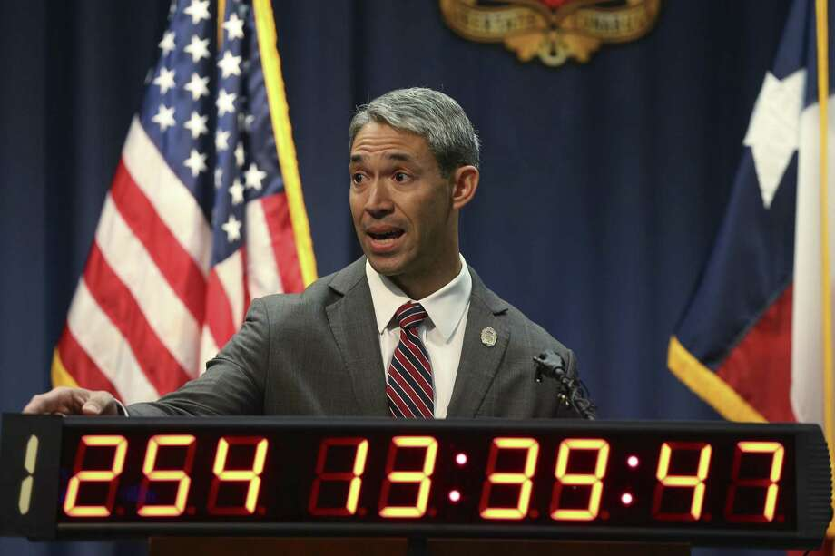 During a press conference, San Antonio Mayor Ron Nirenberg points to a clock counting the days since the firefighters contract expired, Wednesday, March 7, 2018. Nirenberg said that another letter was sent to union asking them to come to the negotiating table. Photo: JERRY LARA, Staff / San Antonio Express-News / © 2018 San Antonio Express-News