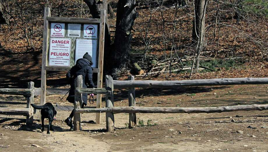 "A woman heads onto the trails at Lake Mohegan, with her leashed dog. Animal Control officers are doing ""zero tolerance"" enforcement of laws on leashes, licensing, and vaccinations. Fairfield,CT. 03/06/18 Photo: Genevieve Reilly / Hearst Connecticut Media / Fairfield Citizen"