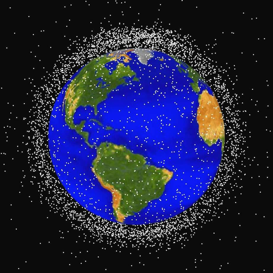 This computer generated graphic provided by NASA in 2011 shows images of objects in Earth's orbit that are currently being tracked. Space junk has made such a mess of Earth's orbit that experts say we may need to finally think about cleaning it up. Photo: /AP / NASA