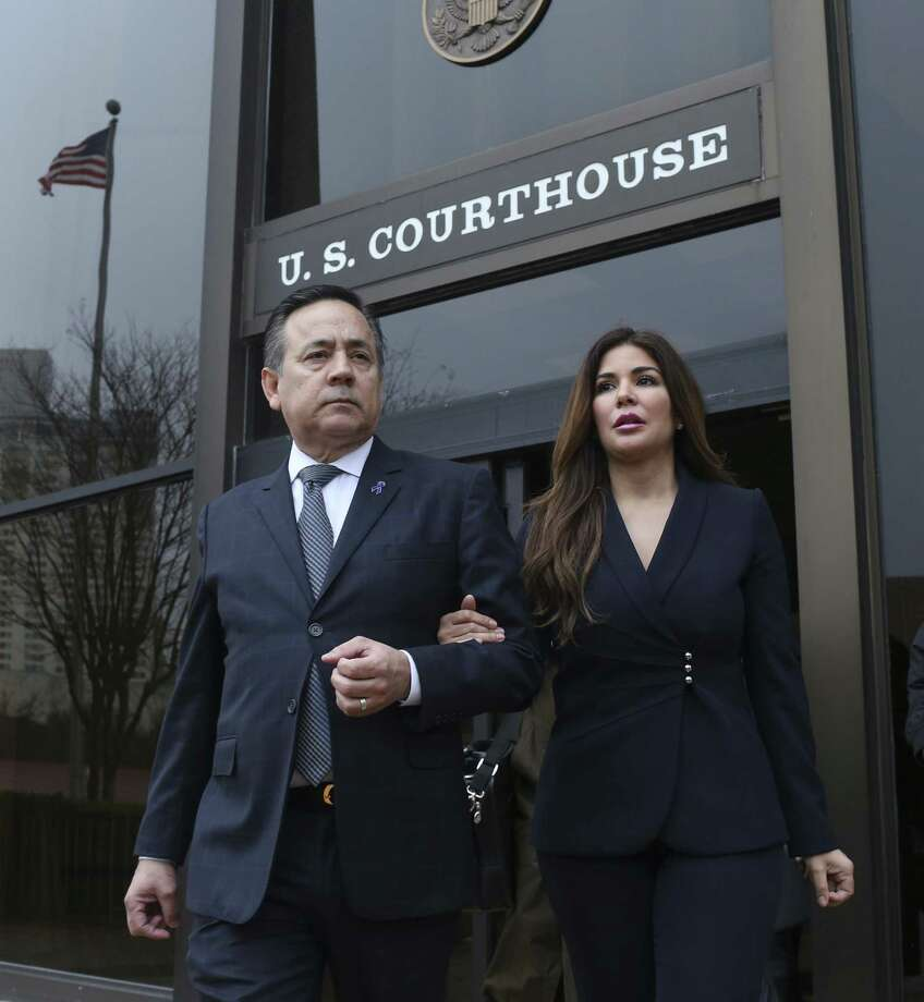 Federal prosecutors sought a restraining order to prevent recently convicted state Sen. Carlos Uresti from dissipating assets. The request was made three or four days after Uresti's wife, Lleanna, filed a divorce petition. They are pictured leaving the San Antonio federal courthouse following his Feb. 22 conviction on 11 felony charges. Photo: Jerry Lara /San Antonio Express-News / © 2018 San Antonio Express-News