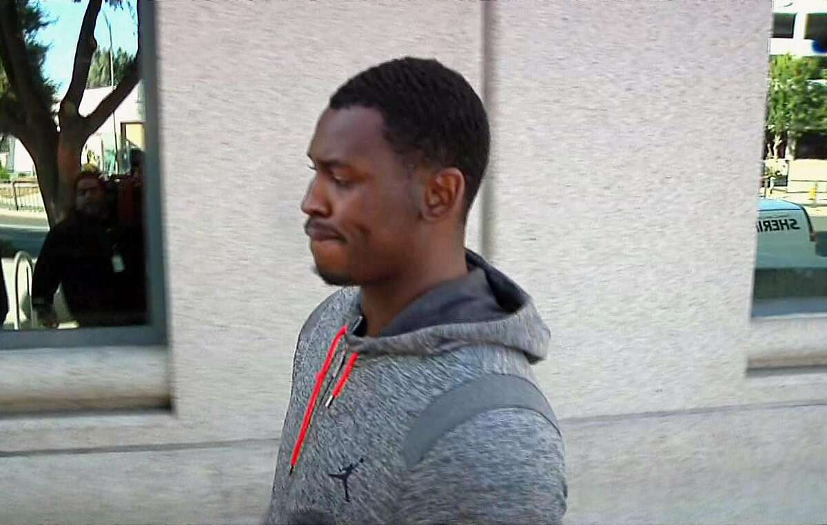 In this image made from video and provided by KNTV, San Francisco 49ers Aldon Smith walks out of Santa Clara County Jail on Friday, Aug. 7, 2015. (Michael Horn/KNTV via AP)