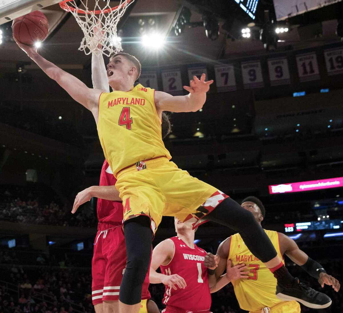 Maryland guard Kevin Huerter (4) goes to the basket during the second half of an NCAA college basketball game against Wisconsin in the second round of the Big Ten conference tournament, Thursday, March 1, 2018, at Madison Square Garden in New York. Wisconsin won 59-54. (AP Photo/Mary Altaffer)
