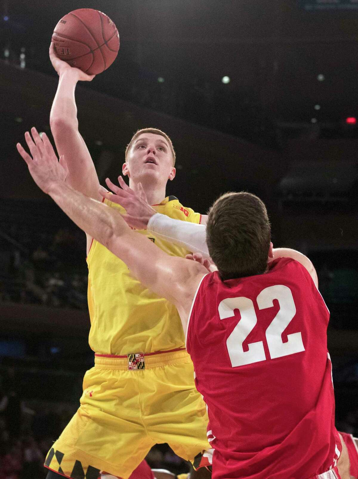 Maryland guard Kevin Huerter goes to the basket against Wisconsin forward Ethan Happ (22) during the second half of an NCAA college basketball game in the second round of the Big Ten conference tournament, Thursday, March 1, 2018, at Madison Square Garden in New York. Wisconsin won 59-54. (AP Photo/Mary Altaffer)