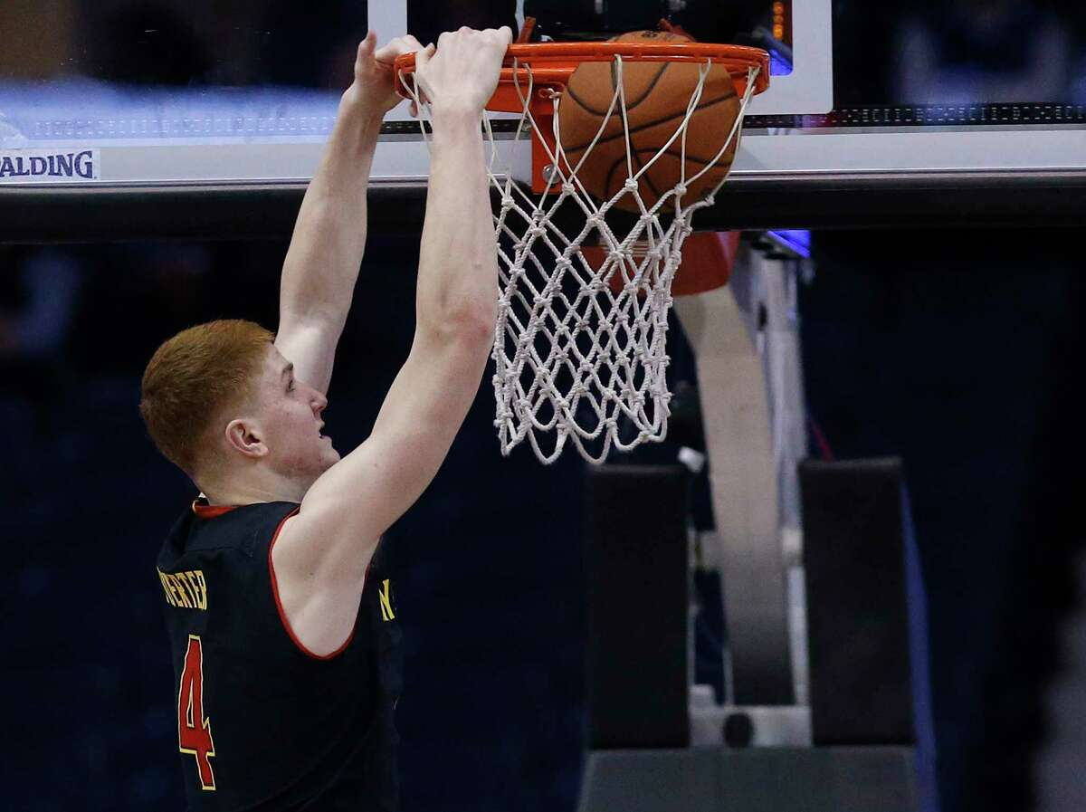Maryland guard Kevin Huerter (4) dunks the ball during the second half of an NCAA college basketball game against Northwestern Monday, Feb. 19, 2018, in Rosemont, Ill. (AP Photo/Jim Young)