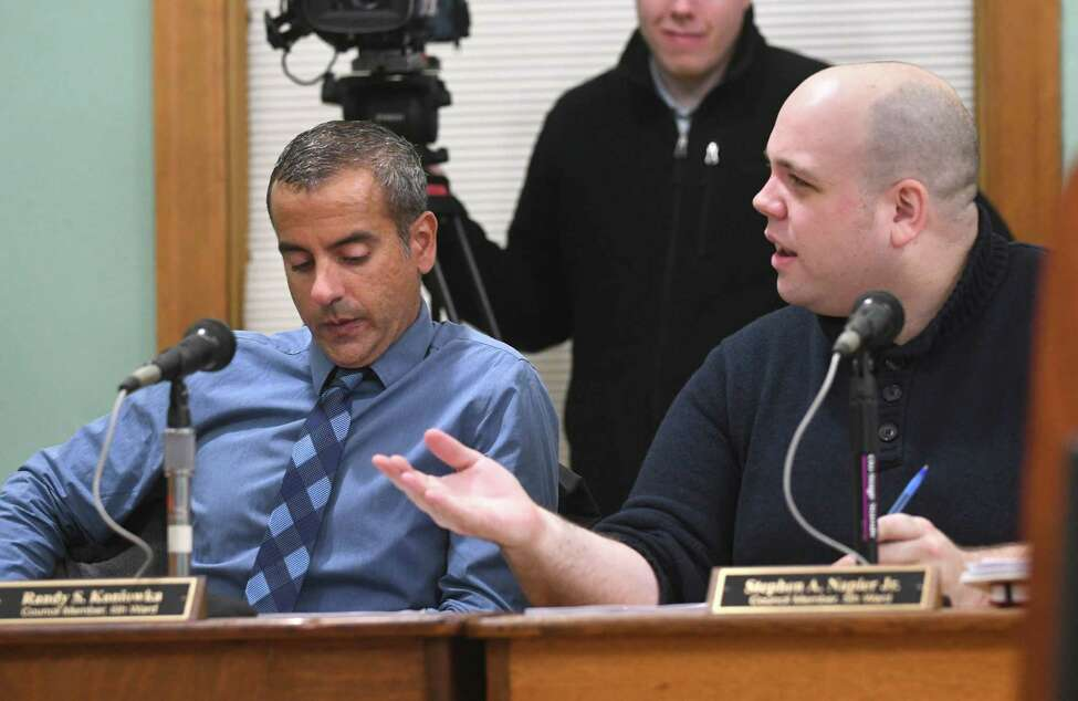 Council member Stephen Napier, right, speaks to Mayor Shawn Morse who leads a public meeting with the Cohoes Common Council at Cohoes City Hall on Tuesday, Dec. 12, 2017 in Cohoes, N.Y. Council member Randy Koniowka sits at left. (Lori Van Buren / Times Union)