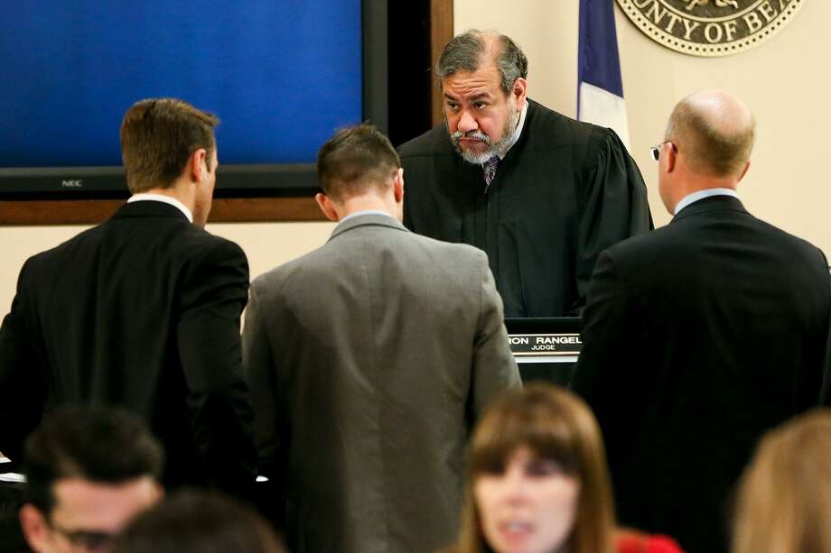 Prosecuting attorneys Josh Somers (from left) and Matthew Ludowig speak to Judge Ron Rangel with defense attorney Albert Gutierrez, Jr. about a question from the jury during the murder trial of Gabriel Moreno in the 379th state District Court on Wednesday, March 7, 2018.  Moreno is one of three people accused of killing Jose Luis Menchaca, who was beaten with aluminum bats, suffocated and dismembered in 2014.  MARVIN PFEIFFER/mpfeiffer@express-news.net Photo: Marvin Pfeiffer, Staff / San Antonio Express-News / Express-News 2018