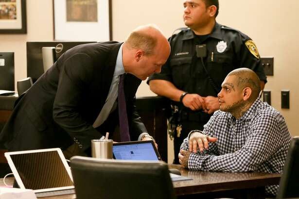 Gabriel Moreno (right) speaks to defense attorney Albert Gutierrez, Jr. (left) after the jury was released for the day in his murder trial last March. That jury deadlocked, but a new jury has heard Moreno's retrial and is expected to get the case today. Moreno is accused of killing Jose Luis Menchaca, who was beaten with aluminum bats, suffocated and dismembered in 2014. MARVIN PFEIFFER/mpfeiffer@express-news.net