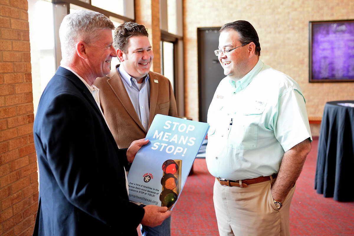 """From left, Midland Police chief Steve Henry, City Councilman J. Ross Lacy, and James Beauchamp, President of Midland-Odessa Transportation Alliance, talk during a """"Cookies with a Cop"""" event March 7, 2018 at Midland Community Theater. James Durbin/Reporter-Telegram"""