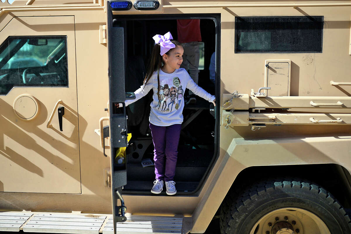 """Camila Barajas, age 6, checks out the inside of a Bearcat armored vehicle belonging to the Midland Police Department SWAT team during a """"Cookies with a Cop"""" event March 7, 2018 at Midland Community Theater. James Durbin/Reporter-Telegram"""