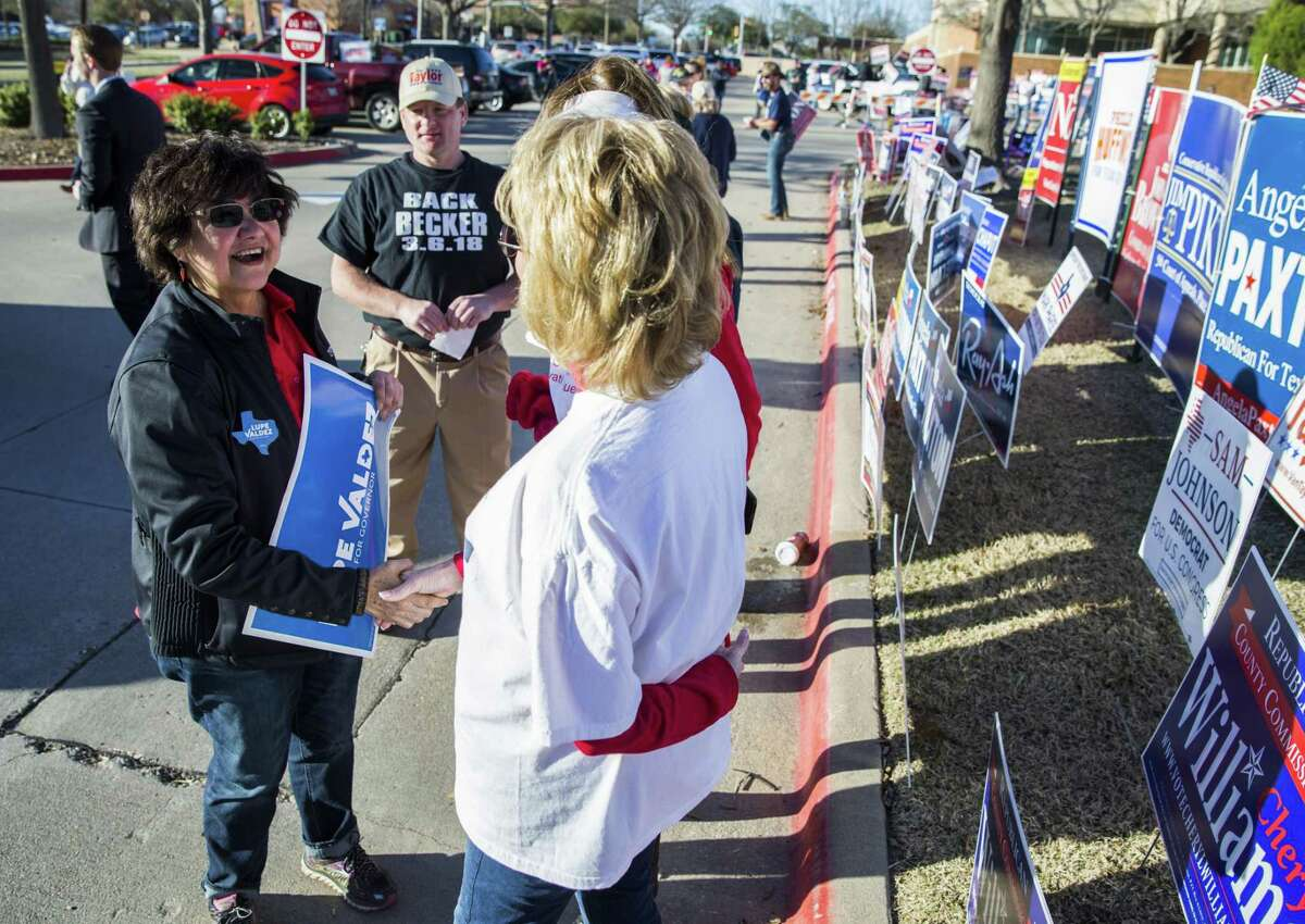 Gubernatorial candidate and former Dallas Sheriff Lupe Valdez greets voters and campaigners outside a polling place at Allen City Hall and on primary election day on Tuesday, March 6, 2018 in Allen, Texas. (Ashley Landis/The Dallas Morning News)