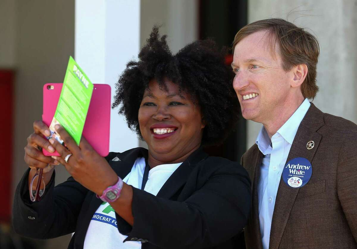 Latosha Payne takes a selfie with gubernatorial candidate Andrew White outside the West Gray Recreation Center Tuesday, March 6, 2018, in Houston. ( Godofredo A. Vasquez / Houston Chronicle )