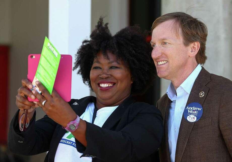 Latosha Payne takes a selfie with gubernatorial candidate Andrew White outside the West Gray Recreation Center  Tuesday, March 6, 2018, in Houston. ( Godofredo A. Vasquez / Houston Chronicle ) Photo: Godofredo A. Vasquez / Houston Chronicle