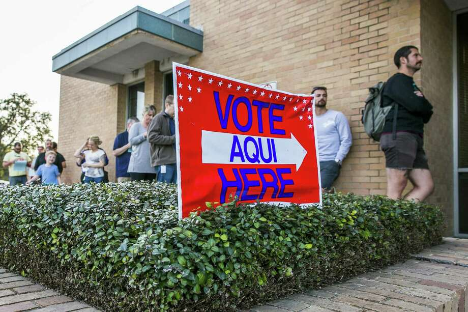 A line of voters wait outside the Gardner Betts Annex in Austin on Tuesday. (Photo by Drew Anthony Smith/Getty Images) Photo: Drew Anthony Smith, Stringer / Getty Images / 2018 Getty Images