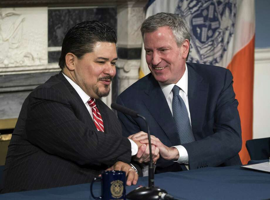 In this photo provided by the Mayoral Photography Office, Richard A. Carranza, left, is introduced by New York Mayor Bill de Blasio, right, as his new choice to lead the nation's largest school system on March 5, 2018, at City Hall in New York. Carranza, who has been the superintendent in Houston since August 2016 and previously was superintendent of the San Francisco school system, was appointed to replace Chancellor Carmen Farina, who's retiring. (Ed Reed/Mayoral Photography Office via AP) Photo: Ed Reed, HONS / Associated Press / Mayoral Photography Office