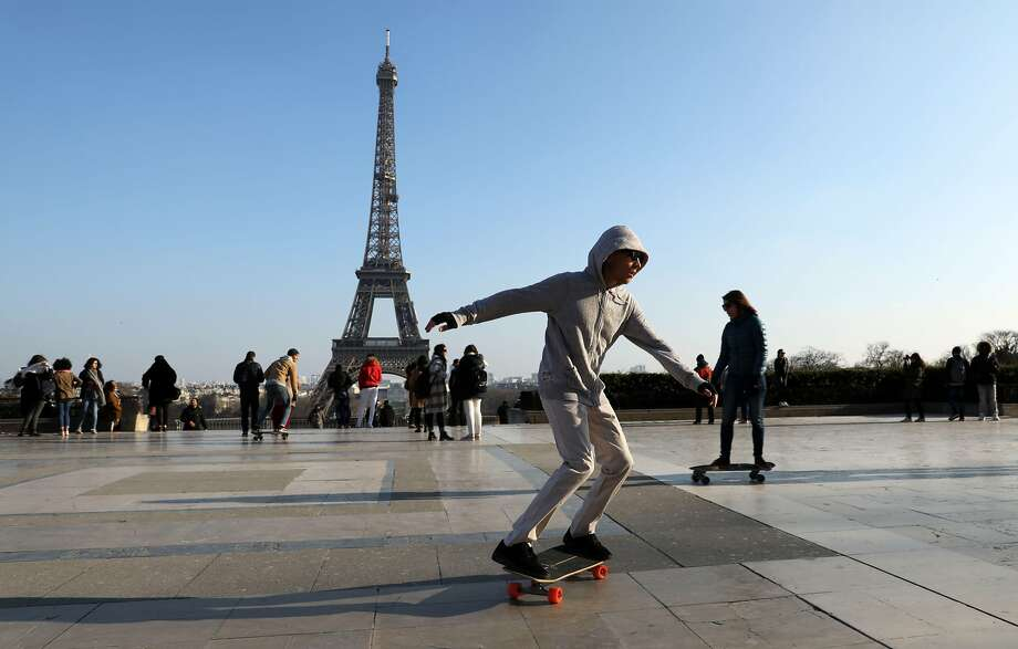 Skateboarders practice their skills on Trocadero Plaza in front of The Eiffel Tower in Paris on February 22, 2018.  / AFP PHOTO / Ludovic MARINLUDOVIC MARIN/AFP/Getty Images Photo: LUDOVIC MARIN, AFP/Getty Images