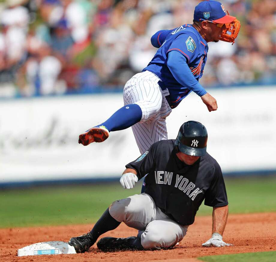 New York Mets second baseman Asdrubal Cabrera (13) avoids New York Yankees' Brett Gardner (11) as he turns a double play on a Brandon Drury ground ball in the third inning of a spring training baseball game Wednesday, March 7, 2018, in Port St. Lucie, Fla. (AP Photo/John Bazemore) Photo: John Bazemore / Copyright 2018 The Associated Press. All rights reserved.