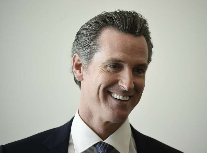 Democratic gubernatorial candidate Gavin Newsom speaks during an interview before a town hall meeting at the 2018 California Democrats State Convention Saturday, Feb. 24, 2018, in San Diego. (AP Photo/Denis Poroy)
