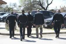 San Antonio Police Department officers leave the Atascosa County Courthouse in Pleasanton Wednesday, March 7, 2018 during a lunch break in the capital murder trial of Shaun Ruiz Puente, 36, who is accused of shooting and killing SAPD Officer Robert Deckard during a multi-county chase Dec. 8, 2013. A jury now has the case.