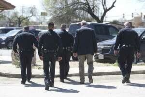 San Antonio Police Department officers leave the Atascosa County Courthouse last month during a lunch break in the capital murder trial of Shaun Ruiz Puente, 36, who was later convicted of killing SAPD officer Robert Deckard in 2013.