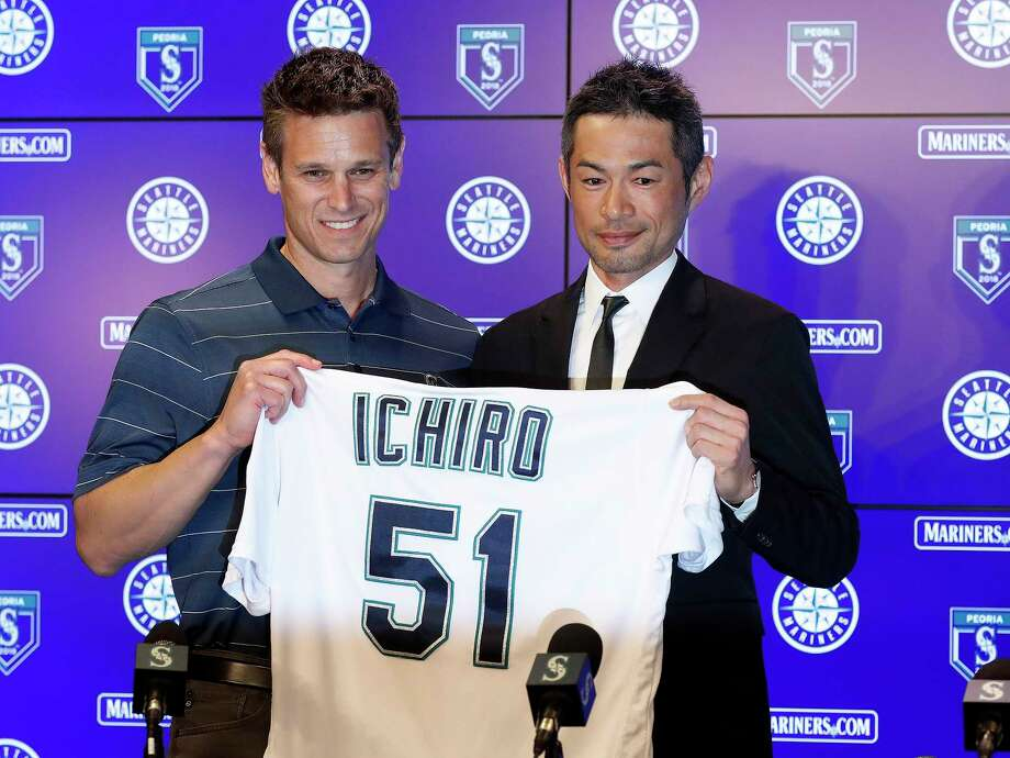 Seattle Mariners' Ichiro Suzuki, right, holds up his jersey with Mariners general manager Jerry Dipoto during a news conference at the teams' spring training baseball complex Wednesday, March 7, 2018, in Peoria, Ariz. Suzuki signed a one-year deal with the team. (AP Photo/Matt York) Photo: Matt York / Copyright 2018 The Associated Press. All rights reserved.