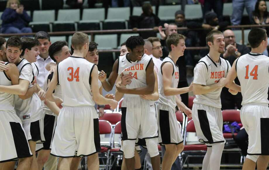 Mohonasen celebrates their overtime victory over Lansingburgh during the Section II Class A boys' basketball semifinal at the Cool Insuring Arena in Glens Falls, NY Wednesday, Feb. 28, 2018. (Ed Burke-Special to The Times Union)