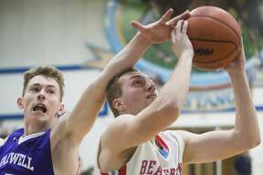 Beaverton junior Logan Gerow takes a shot during the Beavers' district semifinals game against Farwell on Wednesday, March 7, 2018 at Meridian High School. (Katy Kildee/kkildee@mdn.net)