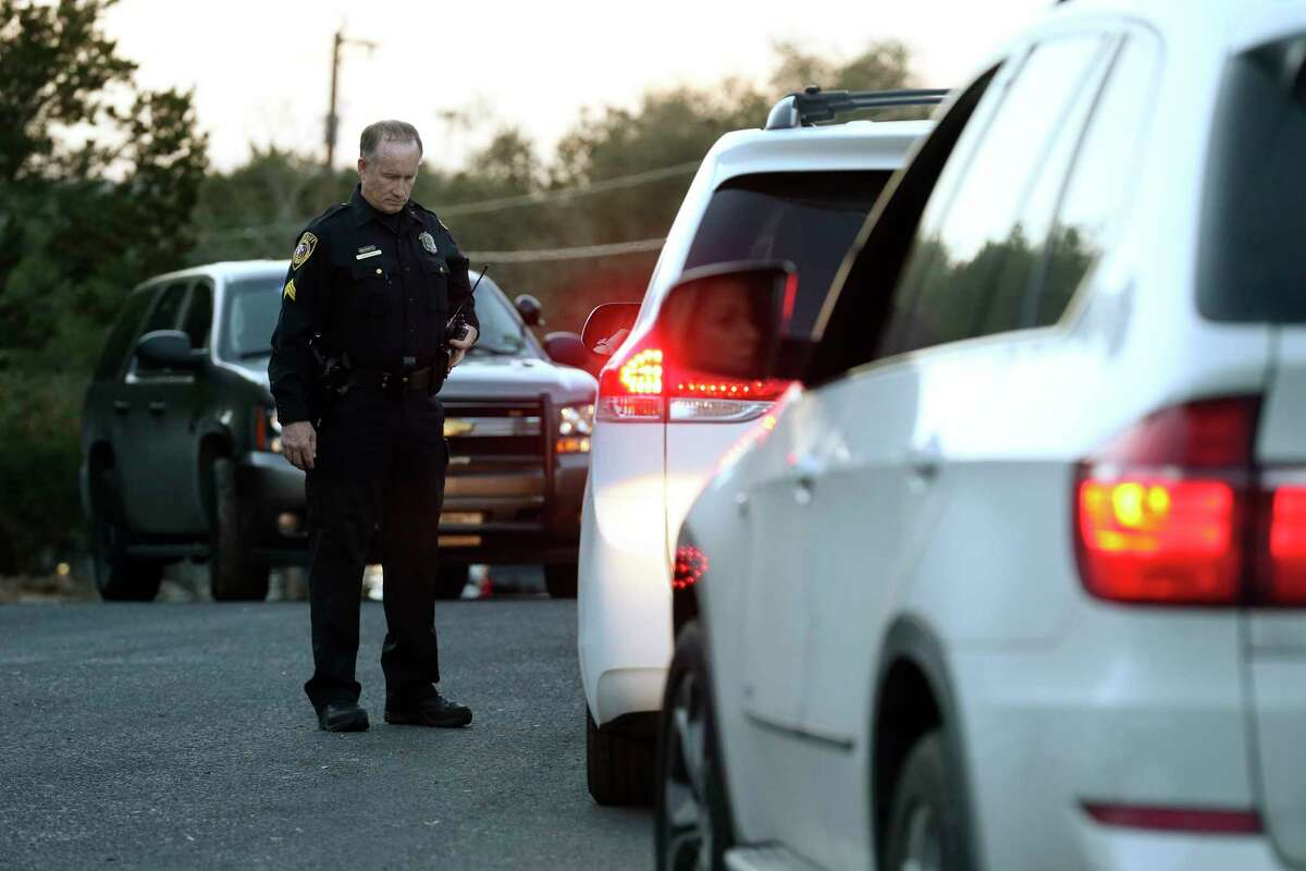 Law enforcement personnel check vehicles near the site of a standoff in the Stage Coach Hills subdivision in northwest Bexar County, Wednesday, March 7, 2018. According to Bexar County Sheriff Department, a man in his 60's barricaded himself with his mother who is in her 80's, Tuesday night. The man fired on deputies and injured two at the house on the 9200 block of Saddle Trail.