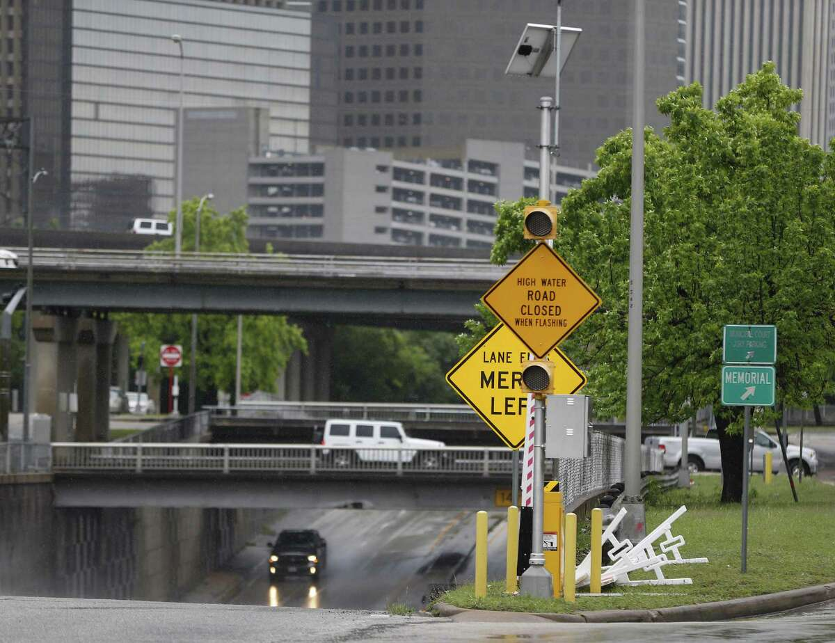 A flooded road warning system sign at Houston Avenue, near Memorial Drive on April 20, 2016, in Houston.