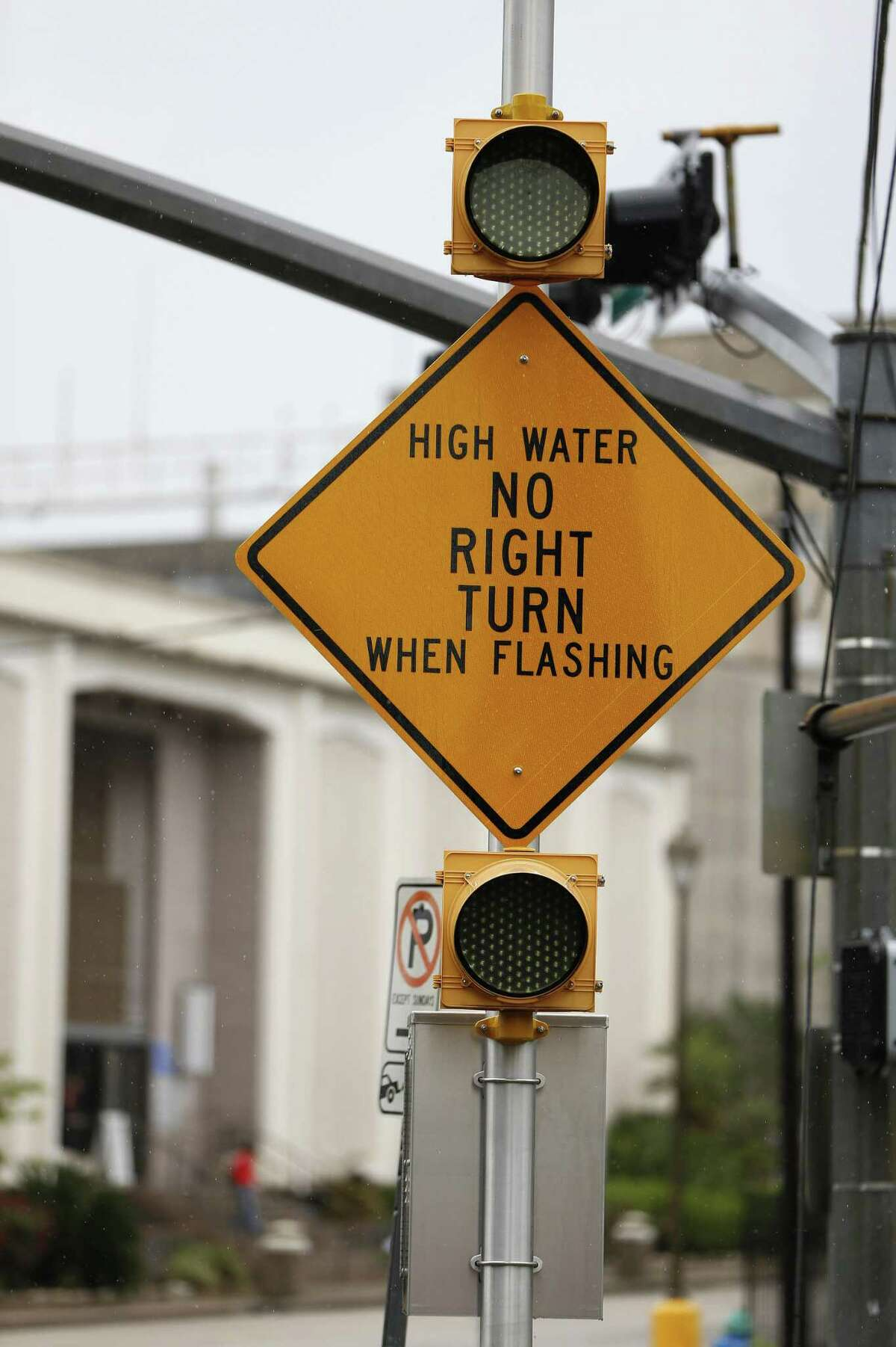 A flooded road warning system sign at Houston Avenue, near Memorial Drive, this one warns drivers not to turn right when flashing to avoid going into flood waters in the underpass on April 20, 2016.Scroll through to see the intersections targeted for flood warning signs