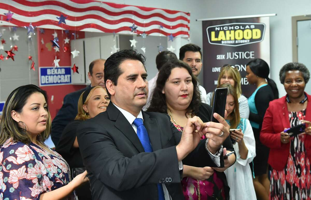 Bexar County Democratic Chairman Manuel Medina takes candidate photo's at a candacy filing Wednesday for Judge Nelson Wolff, Commissioner Paul Elizondo, and District Attoeney Nico LaHood.