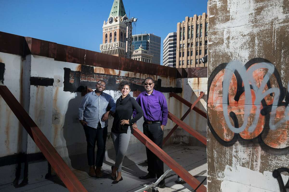 Jimmy Donelson III, Victoria Paykar and Denzel Tongue of The Greenlining Academy's leadership development program that develops multi-ethnic leaders who will advance racial and economic equity, pose on the roof of their offices on Tuesday, March 6, 2018 in Oakland, Calif.